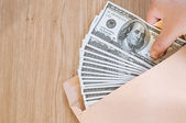 Handling money in brown envelop, bribe — Stock Photo