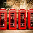 Royalty-Free Stock Photo: Row of british red telephone boxes