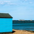 Bright blue Beach Huts — Stock Photo #26476579