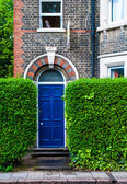 An arched blue door of a victorian english house — Stock Photo