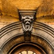 Stock Photo: Arched eneterance door of cambridge University, UK