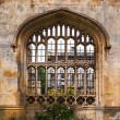 Architecture in Cambridge University, England. Kings College wall with window casting beautiful sunlight — Stock Photo