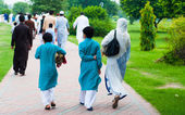 Muslim family going for Eid prayers — Stock Photo