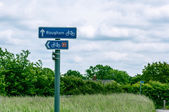 Sign post for Rougham, and cycle lane, Suffolk, Bury St Edmunds, England, UK — Stock Photo