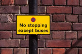 "Sign for ""No stopping except buses"" — Stock Photo"