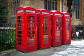 Row of vintage british red BT telephone boxes — 图库照片