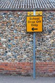 Sign post for school drop off only on UK road — Стоковое фото