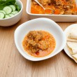 Indian curry lamb rogan josh in a white dish, with naan bread. — Stock Photo #49481265