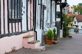 A row of colorful old town houses in Lavenham, England — Stock fotografie