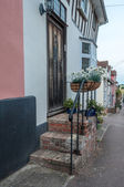 Doorsteps of a row English cottages, Lavenham, UK — Stock fotografie