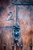 Number 2 on a vintage door with door knocker for use as a background — Stock Photo