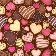 Seamless chocolate pattern with sweetmeat heart - Stock Vector