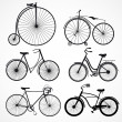 Set of bicycles on a white background — Stock Vector