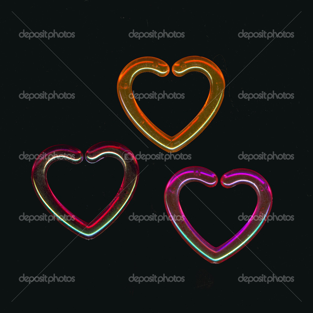 Colorful plastic hearts on a black background. — Stock Photo #12693900