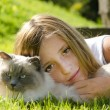 Portrait of a young girl and her cat — Stock Photo