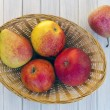 Pears and apples in a basket — Stock Photo