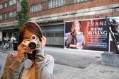 Taking photo with vintage camera — Stock Photo
