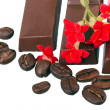 Chocolate red flowers and coffee beans — Stock Photo