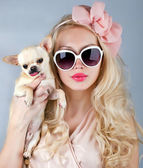 Beautiful woman with chihuahua in hands — Stockfoto