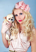 Portrait of young woman with small dog — Stock Photo
