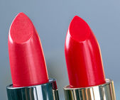 Two red lipsticks — Stock Photo