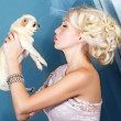 Pretty woman kissing small dog — Stock Photo