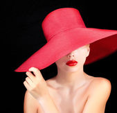 Portrait of attractive woman in red hat — Stock Photo