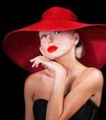 Woman in red hat — Stock Photo