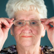 Old smiling woman in glasses — Stock Photo