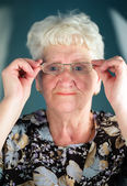 Old woman wearing glasses — Stock Photo