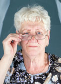 Portrait of grandmother in glassess — Stock Photo