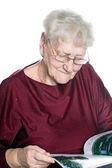 Senior woman reading magazine — Stock Photo