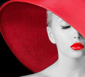 Sexy young girl in red hat — Stock Photo