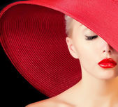 Glamour beautiful woman in red hat — Stock Photo