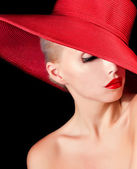 Gorgeous woman in red hat — Stock Photo
