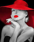 Fashionable lady with red lips in hat — Stock Photo