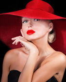 Elegant woman with red lips wearing hat — Stock Photo