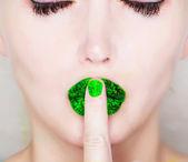 Finger on lips — Stock Photo