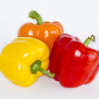 Bell peppers in white background Three bell peppers isolated in white background. Yellow, red and orange colors. — Stock Photo #13440303