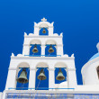 Traditional Greek white church in Oia village,Santorini,Greecee  — Stock Photo