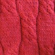 Stock Photo: Red knit sweater close-up