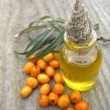 Sea ​​buckthorn oil in jar, close-up — Stock Photo #13951086