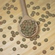 Lentils in wooden spoon on wooden background, close-up — Photo