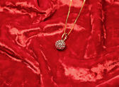 Woman necklace on red velvet background, close-up — Stock Photo