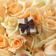 Stock Photo: Gift box on beautiful roses background