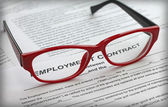 Employment contract and female red glasses, close-up — Stock Photo