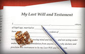 Last Will and Testament form with gold jewelry on red background — Stock Photo