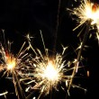 Foto de Stock  : Three burning sparklers, close-up