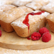 Delicious cakes with raspberries on wooden background, close-up — Foto Stock