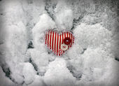Red striped heart on snow background, close-up — Stock Photo